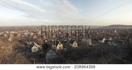 Panoramic evening landscape - a village in the suburbs of the city of Krivoy Rog in Ukraine