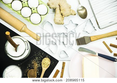 ingredients and tools for baking ginger biscuits - food and kitchen utensils