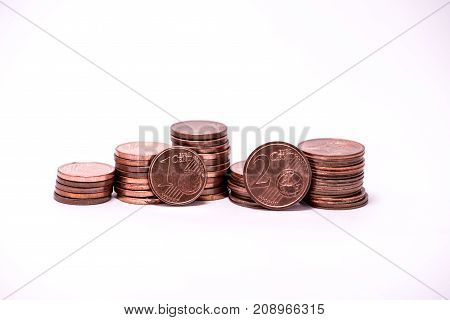 stacks of euro cents one and two cents value white background copper coin