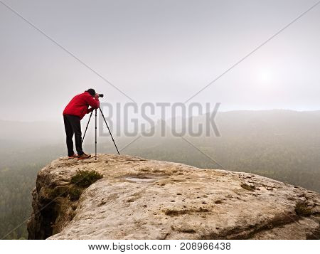 Photographr Looking Into Viewfinder Of Dslr Digital Camera Stand On Tripod. Artist  Photographing Mo