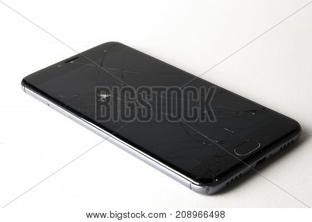 Broken smartphone isolated on a white background