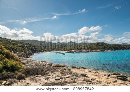 Boats In A Small Cove With Sandy Beach In Corsica