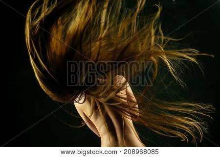 Girl Has No Makeup And Healthy Hair On Black Background
