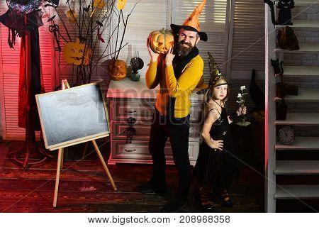 Girl And Bearded Man With Smiling Faces Near Blackboard