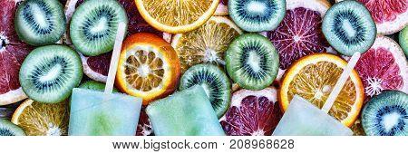 Concept: Summer, Heat, Quenching Thirst. Fruit Ice, Sliced Fruit, Kiwi, Orange, Grapefruit.