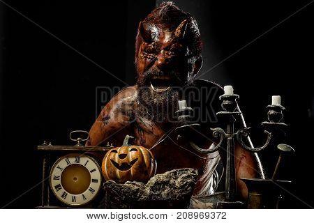Halloween Satan Man With Horns Shout With Pumpkin, Clock, Candlestick