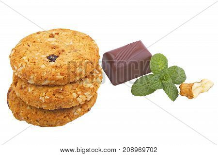 Delicious cookies with chocolate and nuts on white background