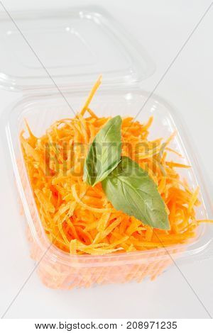 A Grated Carrots Salads In Plastic Trays