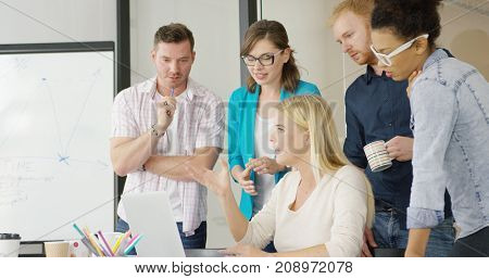 Side view of people in casual clothing working together in modern organization and discussing problems while gathering in conference room.