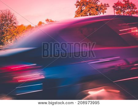 Abstract Motion Blur Picture Of A Fast Driving Car -