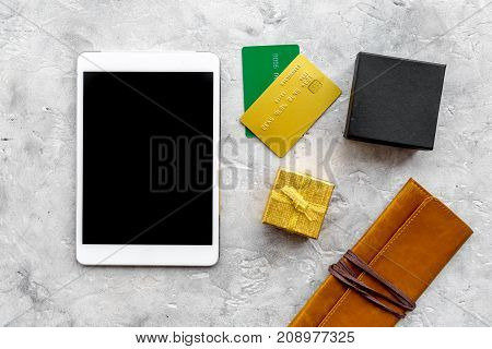 order new year 2018 present with credit card and device on gray stone table background top view mock up