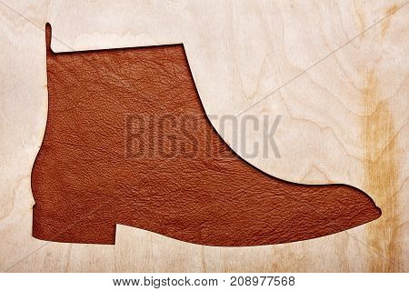 Silhoutte Of Leather Chelsea Boots In The Center.top View.wooden Background.concet Shoes Shop