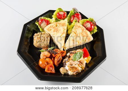 Spanish Omelette Served In Slices. Tortilla De Patatas. White Background For Takeaway