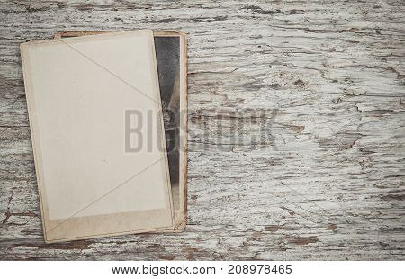 Vintage Background With Old Photos On Wood