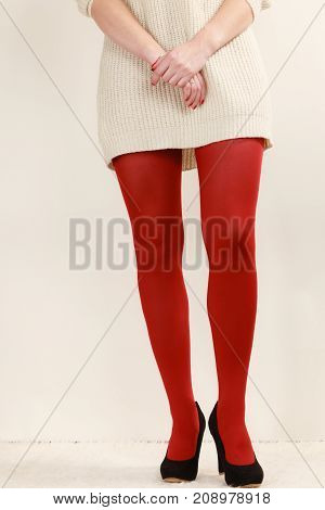 Woman Legs In Red Vivid Color Pantyhose Black High Heels Shoes