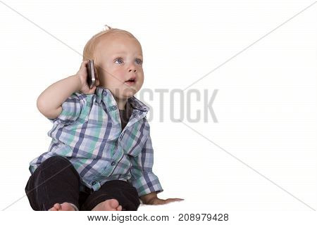 Cute toddler speaking on phone. Isolated. Copy space