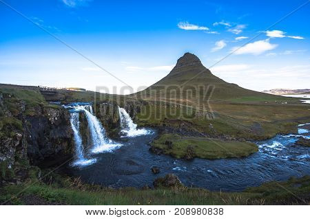 Summer Sunset Over The Famous Kirkjufellsfoss Waterfall