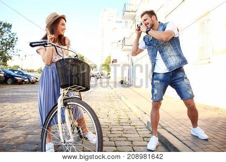 Couple in love outdoors. Happy tourist girl posing for photo