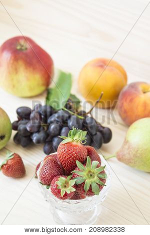 Fresh fruits. Healthy food. Mixed fruits are grapes, pears, peaches, strawberries. eat, diet, like fruit. Studio photography of various fruits on an old wooden table. Organic healthy assorted fruits. Assortment of fresh fruits. . Fruit food background.
