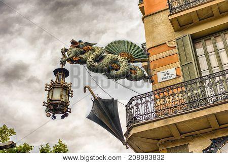 Chinese Dragon Holding A Lantern, La Rambla, Barcelona, Catalonia, Spain