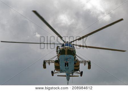 Tyumen Russia - August 4 2017: International Army Games. Engineering Formula contest. Military helicopter MI-8 with mine equipment in the cloudy sky