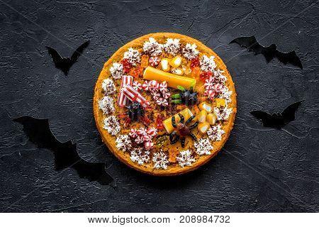 Halloween tradition. Pumpkin pie on black background top view.