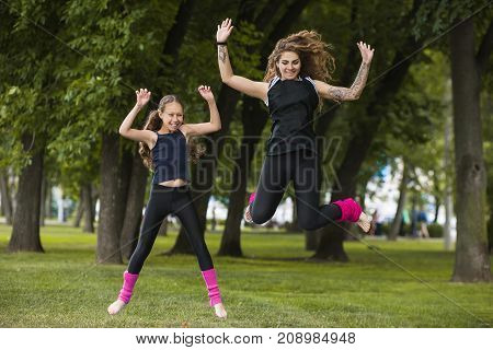 Forever young. Fun activity together. Happy and beautiful females leisure time, nature background. Joyful jumps in park, playful active friends, happiness concept