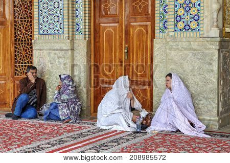 Fars Province Shiraz Iran - 19 april 2017: Shah Cheragh Shrine iran shrine shiraz shrine muslim pilgrims are sitting in the courtyard.
