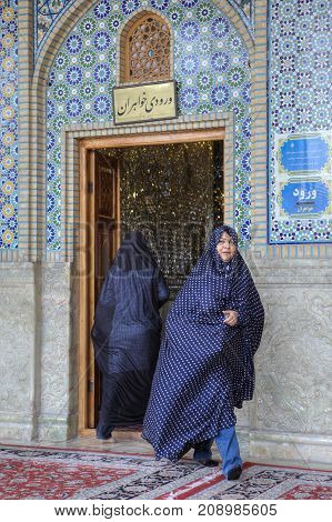 Fars Province Shiraz Iran - 19 april 2017: Shah Cheragh Shrine Muslim women in veils entering into and exiting out of the mosque.