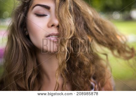 Female beauty closeup. Pretty youth portrait. Relaxed woman, pleasure feeling. Beautiful girl hair, fashion concept
