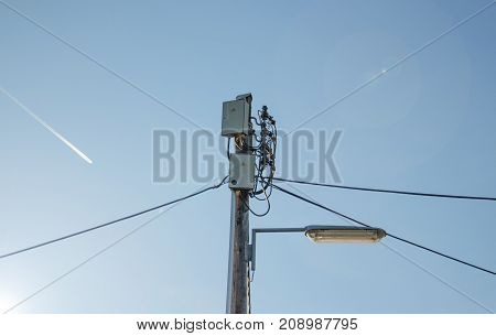 Electric cables wiring and public light on pole