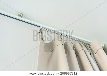 White Curtain Rail System With Light Brown Curtain