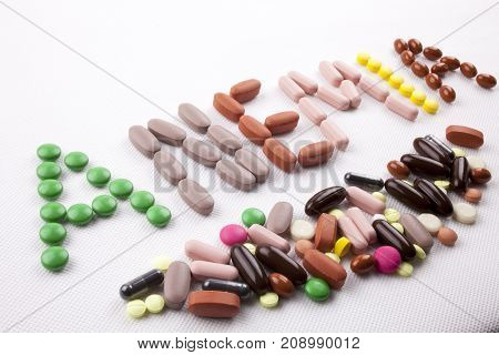 Hand Writing Medical Care Concept Written With Pills Drugs Capsule Word Anemia On White Isolated Bac