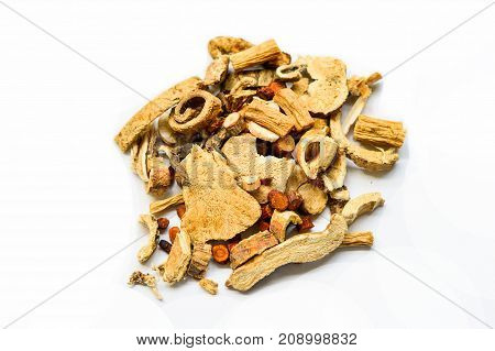 Dried Chinese Herbs Isolated on Centre of White Background.