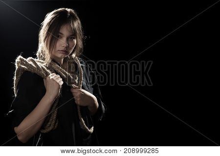 woman executioner with wrap on black background