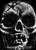 Old scary human skull in the dark poster