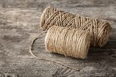 Hanks of hemp twine on wooden background poster