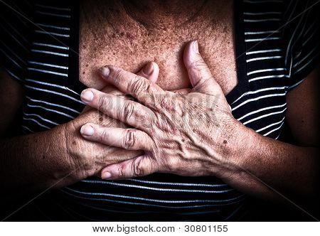 Close up of an old woman's hands over her chest