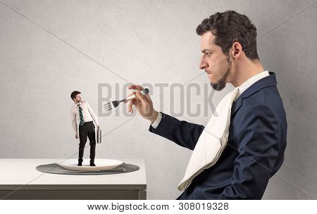 Tiny scared weak businessman almost devoured by great power poster