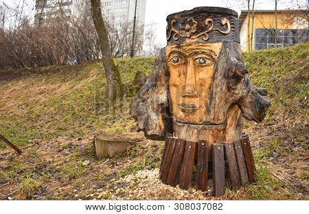 Wooden Sculpture In The Park In The Shape Of Woman's Face