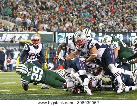 EAST RUTHERFORD, NJ - NOV 22:New York Jets running back Bilal Powell (29) scores a touchdown against the New England Patriots at MetLife Stadium on November 22, 2012 in East Rutherford, New Jersey.
