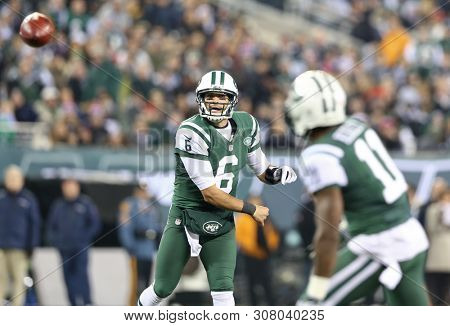 EAST RUTHERFORD, NJ - NOV 22: New York Jets quarterback Mark Sanchez (6) throws a pass to wide receiver Jeremy Kerley (11) against the New England Patriots at MetLife Stadium on November 22, 2019.