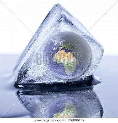 "Frozen earth globe inside the ice cube. ""Elements of this image furnished by NASA"""