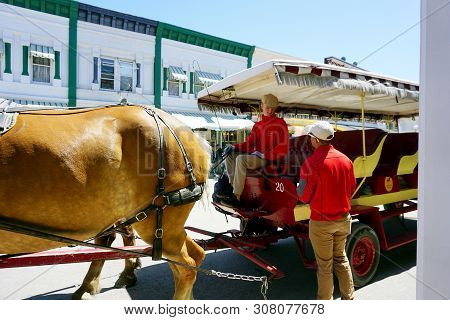 Mackinac Island, Michigan / United States - June 11, 2018: A Coachman For The Mackinac Island Carria