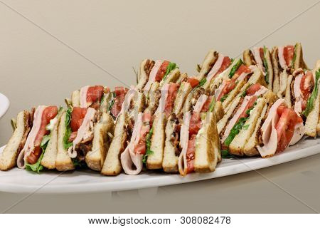 Club Sandwich With Turkey, Bacon, Tomato And Bread