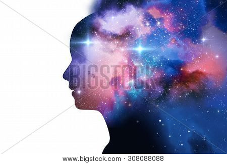 Silhouette Of Virtual Human With Aura Chakras On Space Nebula , Represent Meditation,yoga  And Deep