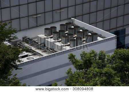 Commercial Cooling Hvac Air Conditioner Condenser On Large Commercial Building Rooftop For Climate C