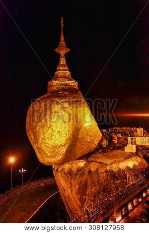 Kyaiktiyo Pagoda Also Known As Golden Rock Is A Well-known Buddhist Pilgrimage Site In Myanmar, Nigh