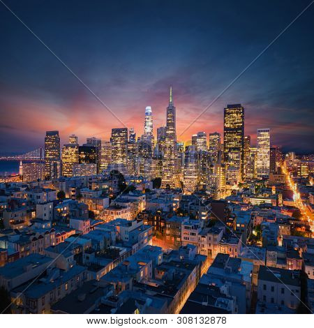 San Francisco Downtown at sunrise. California famous city at sunrise. Bay Bridge and Port of San Francisco in background