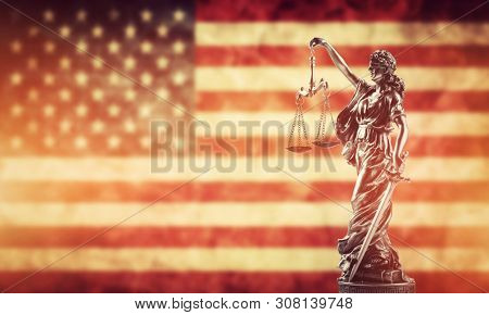 Law concept. Themis statue against USA flag. Symbol of justice, court, trial.